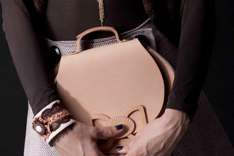 Slay any outfit with nude handbag clutch