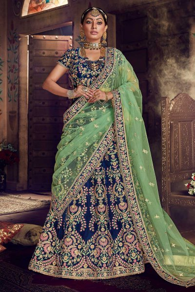 Heavy Embroidered Lehenga in Velvet with Net Dupatta