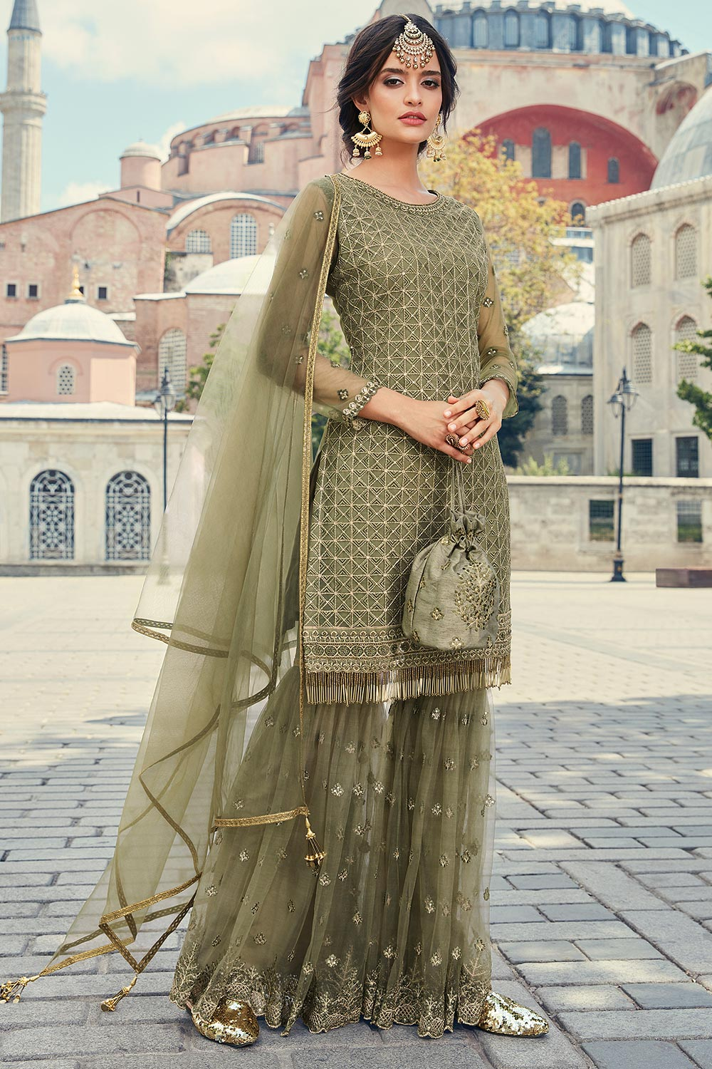 Ravishing sage green sharara suit in net