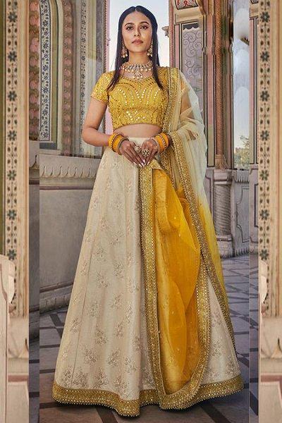 Beige and Mustard Floral Printed Handloom Silk Lehenga with Gota Work Choli and Dupatta