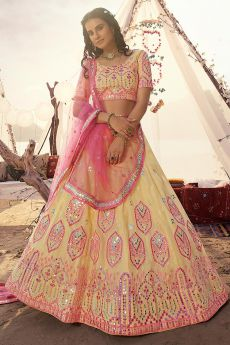 Pale Yellow Mirror Embellished Organza Silk Lehenga Choli