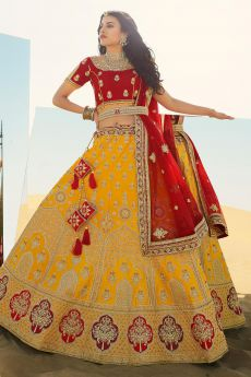 Yellow and Red Beautifully Embroidered Silk Lehenga Choli