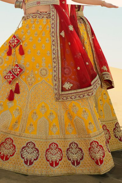 Yellow and Red Beautifully Embroidered Silk Lehenga Choli