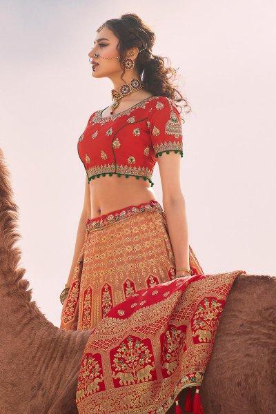 Dark Peach and Red Zari Embroidered Silk Lehenga Choli with Kundan Work