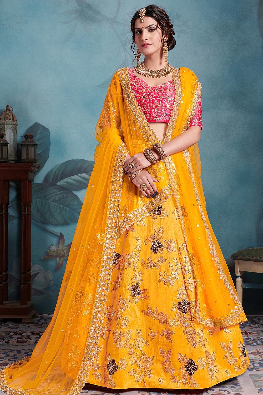 Beautiful Yellow and Coral Pink Zari Embroidered Lehenga Choli