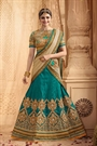 Stunning and Luxe Teal Green Heavy Embroidered Rome Silk Lehenga Set