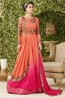 Luxurious and Royal Shaded bright pink and orange Anarkali lehenga suit.