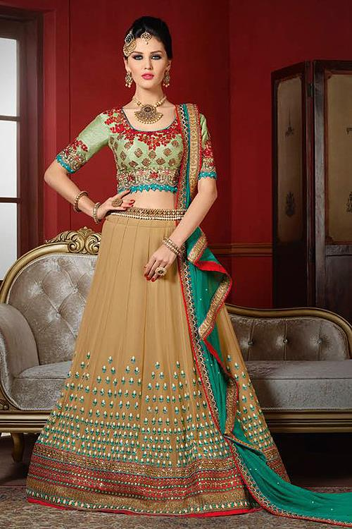 Luxurious Pastel Green And Beige Heavy Embroidered Raw Silk Designer Lehenga