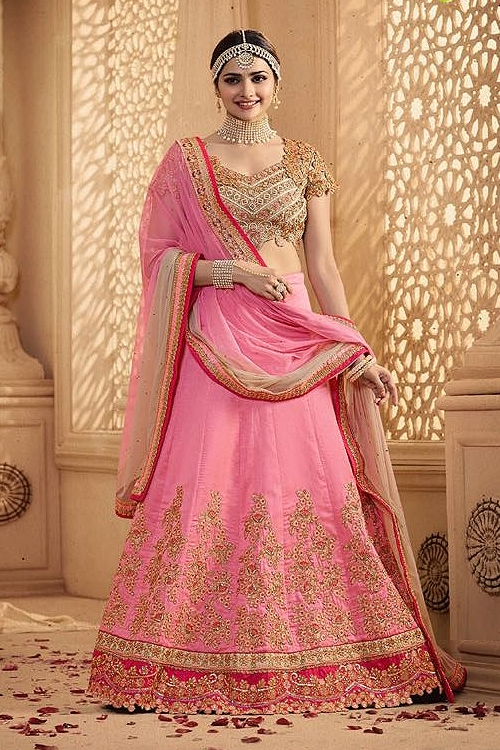 Royal and Elegant Pink beige heavy embroidered lehenga suit