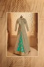 Beige and Turquoise Green Heavy Embroidered Net Georgette Lehenga Suit