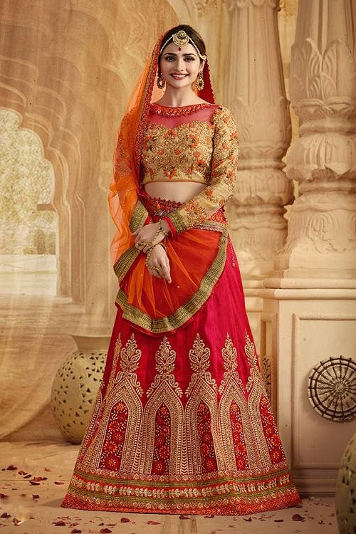 Crimson red and orange heavy embroidered lehenga suit